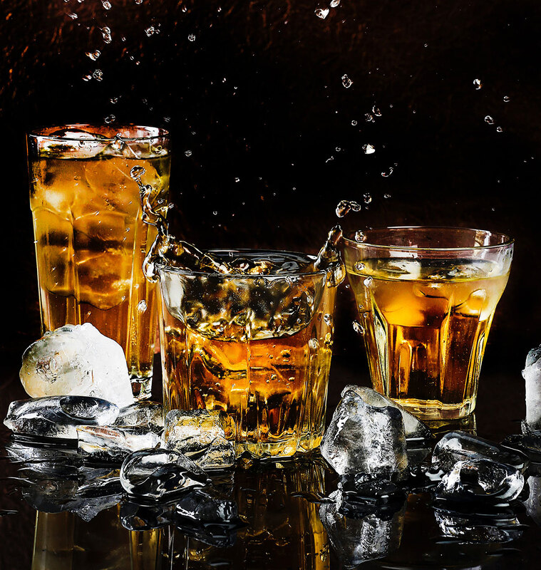 Three glasses of whisky on the rocks