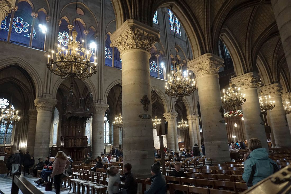 Interior of the Notre Dame in Paris, France decorated for Christmas