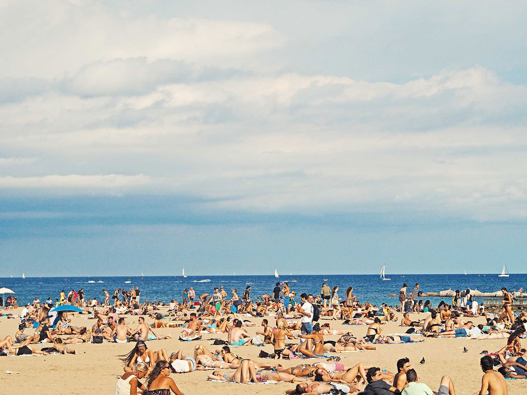 Beach in Barcelona, Spain, filled with tourists
